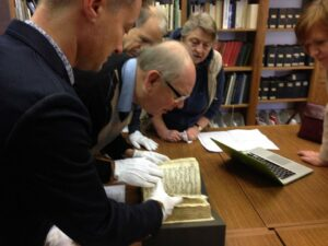 Jaap van Benthem and his colleagues studying the Strahov Codex.